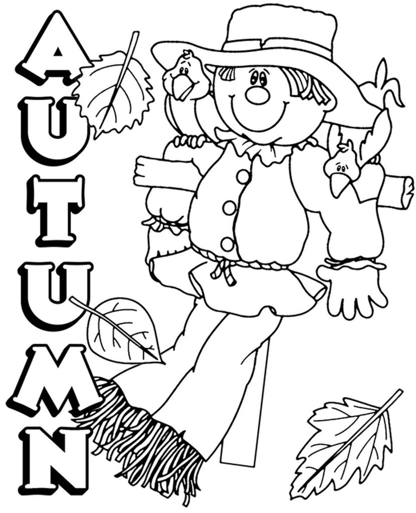 Scarecrow And Leaves In The Autumn